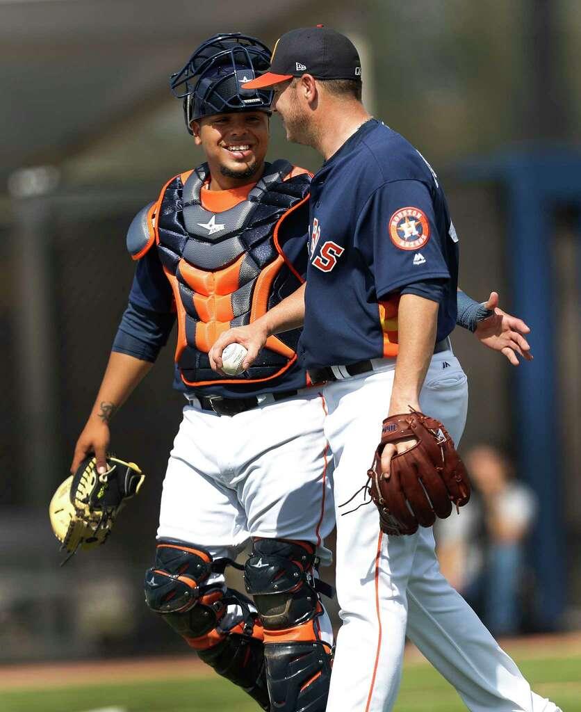 Houston Astros catcher Juan Centeno (30) chats with pitcher Brad Peacock (41)