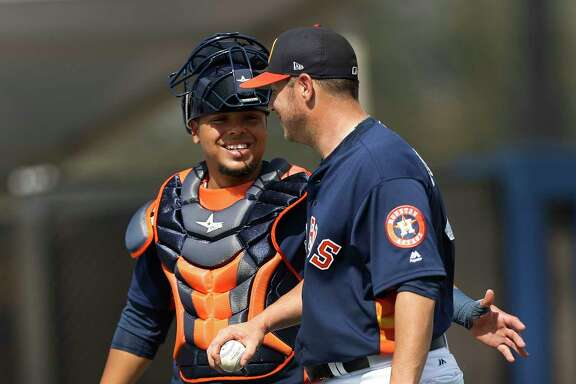 Houston Astros catcher Juan Centeno (30) chats with pitcher Brad Peacock (41) after Peacock's live BP session during spring training at The Ballpark of the Palm Beaches, in West Palm Beach, Florida, Monday, February 20, 2017.