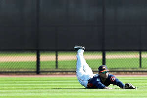 Houston Astros outfielder Ramon Laureano (78) dives for a ball in the outfield during spring training at The Ballpark of the Palm Beaches, in West Palm Beach, Florida, Monday, February 20, 2017.