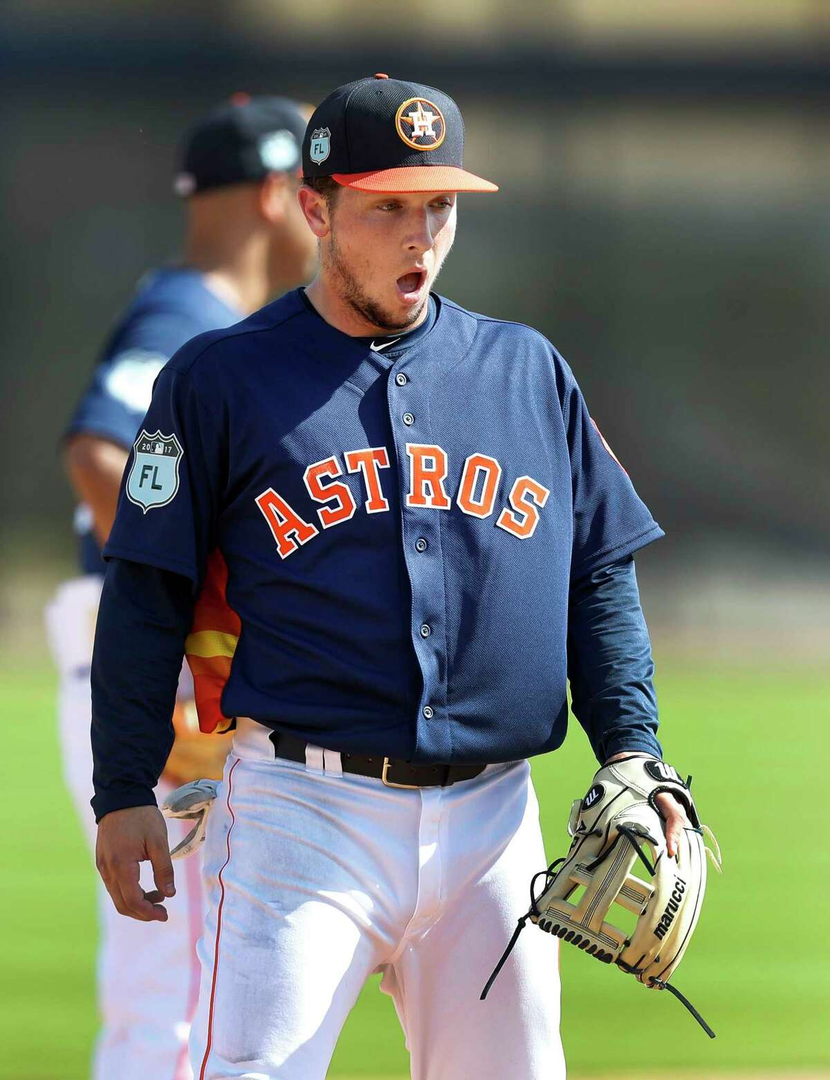 Houston Astros third baseman Alex Bregman (2) reacts after getting popped in the face during infield defensive work during spring training at The Ballpark of the Palm Beaches, in West Palm Beach, Florida, Monday, February 20, 2017.