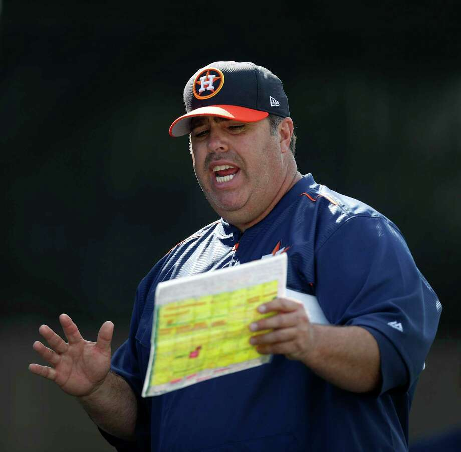 Houston Astros bullpen coach Craig Bjornson (52) give instruction to pitchers during spring training at The Ballpark of the Palm Beaches, in West Palm Beach, Florida, Monday, February 20, 2017. Photo: Karen Warren, Houston Chronicle / 2017 Houston Chronicle