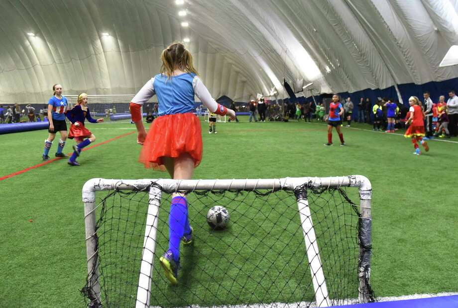 Two girls teams from Bethlehem compete during a charity soccer tournament to benefit twin soccer players whose parents died in a horrific car crash at Afrims Latham Dome on Monday, Feb. 20, 2017 in Latham, N.Y. (Lori Van Buren / Times Union) Photo: Lori Van Buren / 40039740A