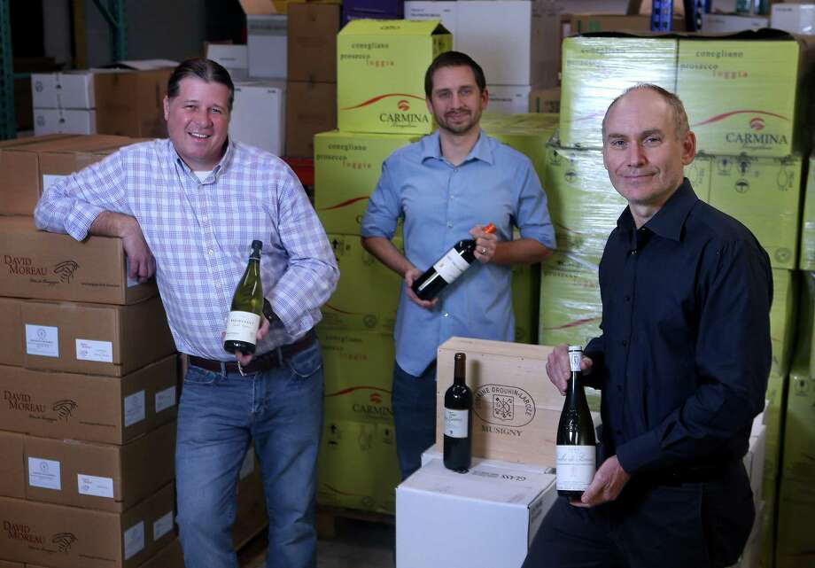 Ross Tefteller, from left, Brian Sandefur and Douglas Skopp, of Dionysus Imports, are featuring newly acquired wines. Photo: Mark Mulligan, Staff / © 2017 Houston Chronicle