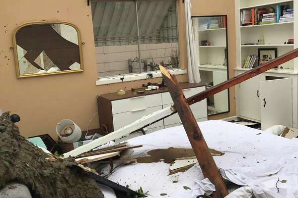 Damage of a home in the 300 block of Burnside Drive after tornadoes tore through San Antonio Sunday, Feb. 19, 2017.