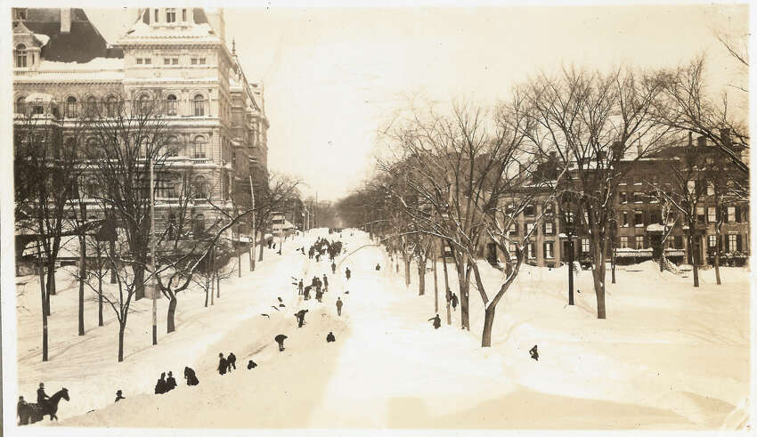 Photo cutline: Dozens of shovelers hunt for Washington Avenue after the Blizzard of 1888. Photo courtesy of the Albany Public Library.