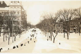 Photo cutline: Dozens of shovelers hunt for Washington Avenue after the Blizzard of 1888. Photo courtesy of the Albany Public Library.