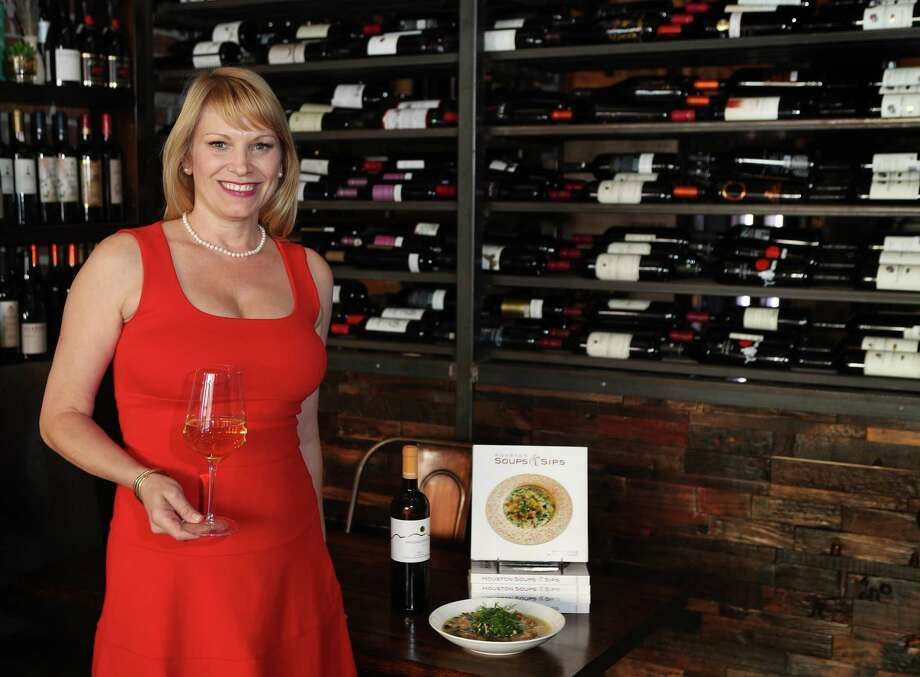 Erin Hicks with her book on soups and a wine at Helen Greek Food & Wine Thursday, Feb. 9, 2017, in Houston. ( Steve Gonzales  / Houston Chronicle ) Photo: Steve Gonzales, Staff / © 2017 Houston Chronicle