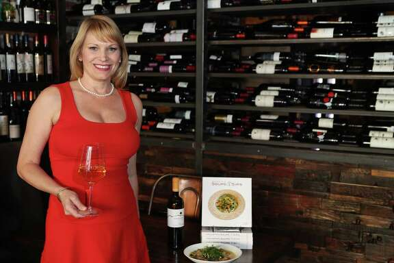 Erin Hicks with her book on soups and a wine at Helen Greek Food & Wine Thursday, Feb. 9, 2017, in Houston. ( Steve Gonzales  / Houston Chronicle )