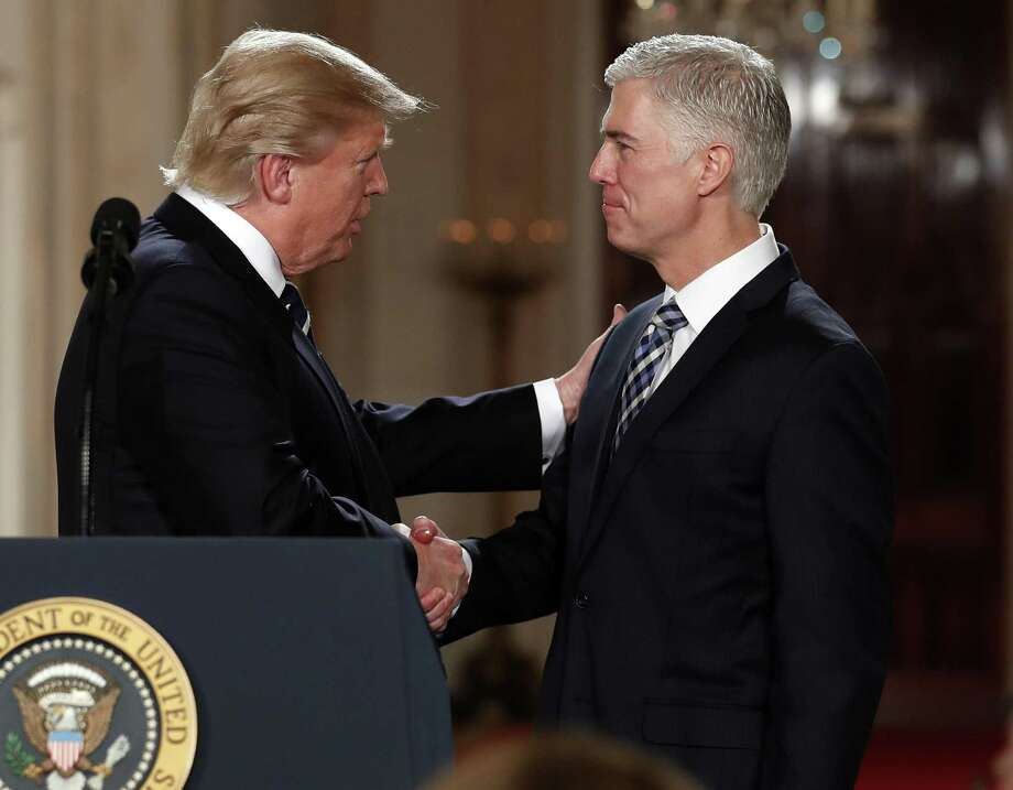 """President Donald Trump shakes hands with Judge Neil Gorsuch, his choice for the Supreme Court. A reader does not regard the position as a """"stolen seat"""" even though Republicans denied Merrick Garland, the man nominated by President Obama, from a hearing in the Senate. Photo: Carolyn Kaster /Associated Press / Copyright 2017 The Associated Press. All rights reserved."""