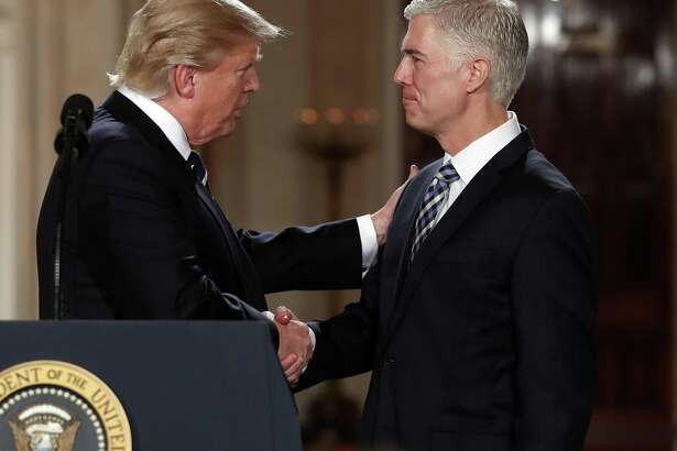 "President Donald Trump shakes hands with Judge Neil Gorsuch, his choice for the Supreme Court. A reader does not regard the position as a ""stolen seat"" even though Republicans denied Merrick Garland, the man nominated by President Obama, from a hearing in the Senate."