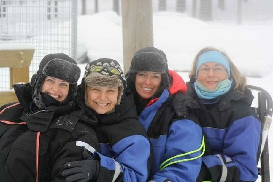 "Sarah Wechsler, Antoinette Martinez, Anne Marie Fallon and Mary Gibbons prepare to say ""Mush"" before a ride on their dog sled. Photo: / Contributed"