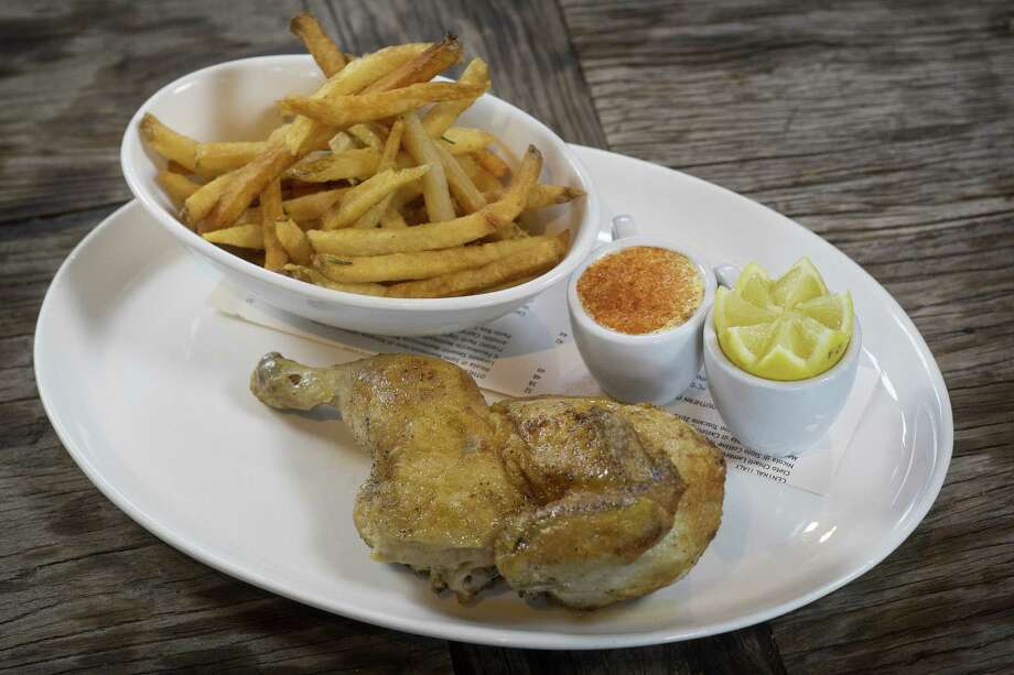 Roasted chicken with french fries at Osteria Il Sogno Photo: Express-News File Photo / San Antonio Express-News