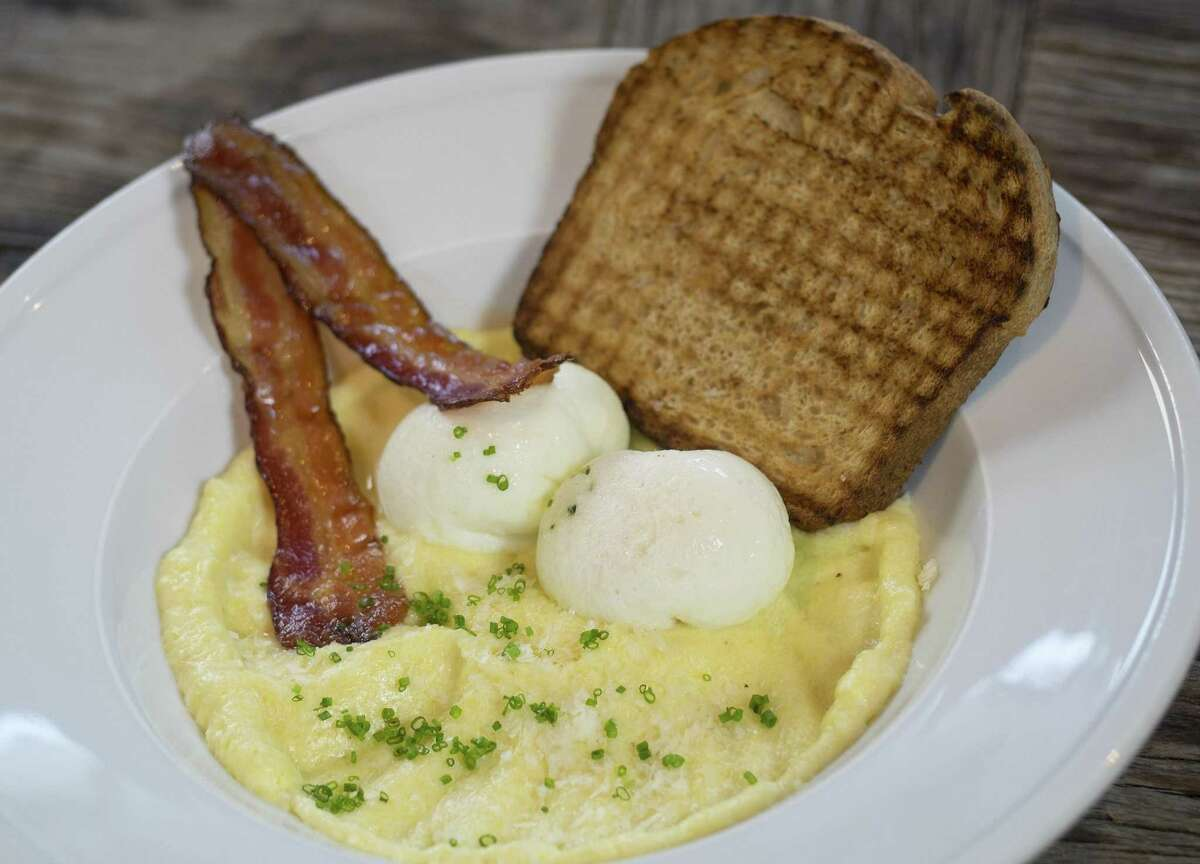 Coddled eggs on soft polenta at Osteria Il Sogno