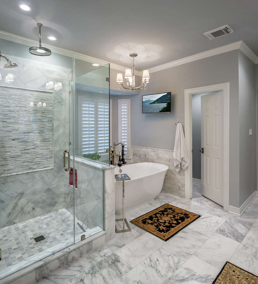 In the master bathroom, the old garden tub was removed to make room for a sleeker freestanding bathtub. Photo: Michael Hart / ©Copyright 2016 All Rights Reserved