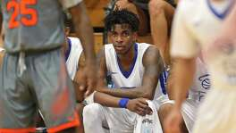 Our Lady of the Lake UniversityÕs Joe Jackson and teammates watch action against Langston University from the bench Thursday Feb. 9, 2017 at Mabee Gymnasium on the OLLU campus. Langston won 96-73.