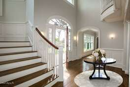 The colonial house at 315 Elm Street has 15 well-proportioned rooms on three finished floors and outstanding millwork starting from the entrance foyer.