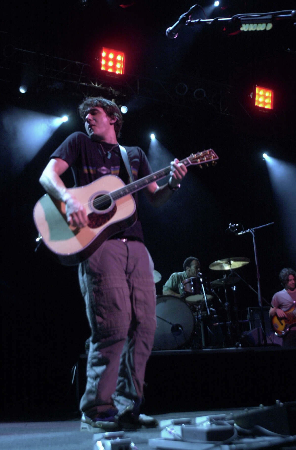 FILE PHOTO - 8/20/02, Pop singer John Mayer performs at the Meadows Music Center in Hartford on Wednesday. His group headlined, while Counting Crows, and Stew opened the show.