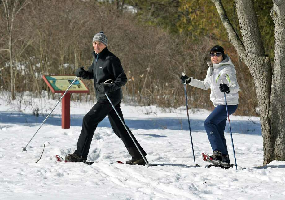 Vladimir Ablin, left, and his wife Anna Dubrova of Selkirk snow shoe through Five Rivers Environmental Center Friday Feb. 17, 2017 in New Scotland, NY.  (John Carl D'Annibale / Times Union) Photo: John Carl D'Annibale, Albany Times Union