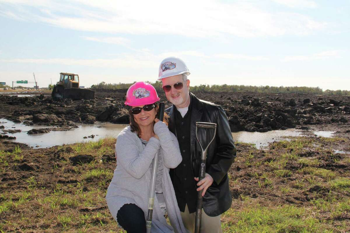 """Dr. Harvey Slusky and his wife, Lisa, visit the site of the planned Adventure Pointe amusement park in Texas City. His family has as background in operating amusement parks and the miniature train at the Houston Zoo. Amusement parks are in my blood,"""" he says."""