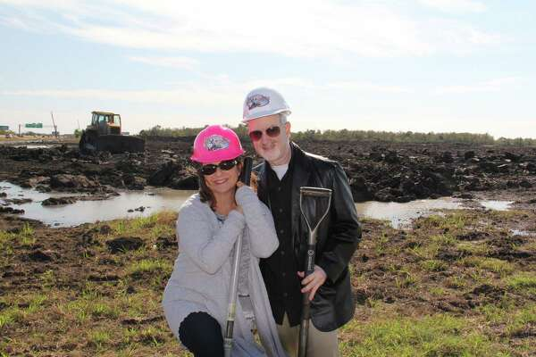 "Dr. Harvey Slusky and his wife, Lisa, visit the site of the planned  Adventure Pointe amusement park in Texas City. His family has as background in operating amusement parks and the miniature train at the Houston Zoo. Amusement parks are in my blood,"" he says."
