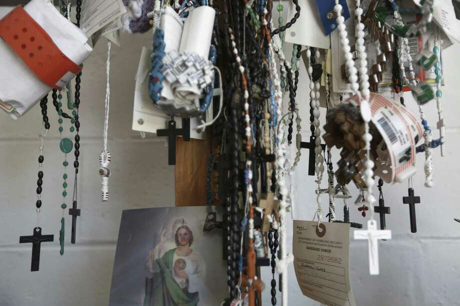 Dozens of migrant detention center bracelets and rosaries hang from a cross inside a migrant shelter in Ciudad Juarez. Photo: Christian Torres /Associated Press / Copyright 2016 The Associated Press. All rights reserved.