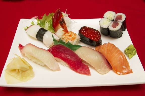 A sushi mix of snapper, tuna, yellowtail, smoked salmon, octopus, shrimp, salmon roe, cucumber roll and tuna roll at Niki'sTokyo Inn