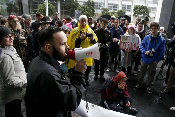 CCSF trustee Tom Temprano speaks during a protest against President Trump at the Phillip Burton Federal Building in San Francisco, Calif. on Monday, Feb. 20, 2017.