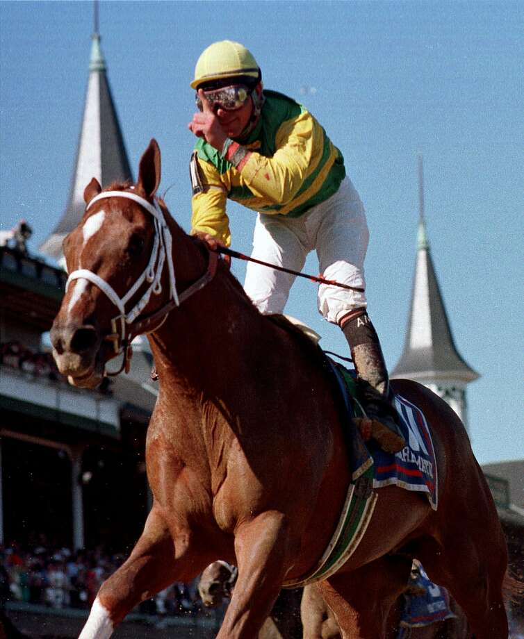 Jockey Chris Antley gestures aboard Charismatic after crossing the finish line to capture the 125th Kentucky Derby on May 1, 1999. Photo: AL BEHRMAN, Associated Press
