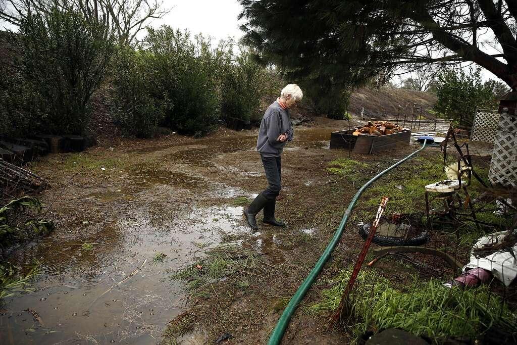 San Joaquin River Club Resident Marie Rucker Surveys Her Backyard Near The Levee That Separates Her