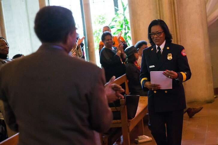 Oakland Fire Chief Teresa Deloach Reed recieves a standing ovation during Oakland NAACP's community event, Exposing Hidden Figures in our Community, in celebration of Black History Month at the Chapel of the Chimes in Oakland, Calif. Monday, February 20, 2017.