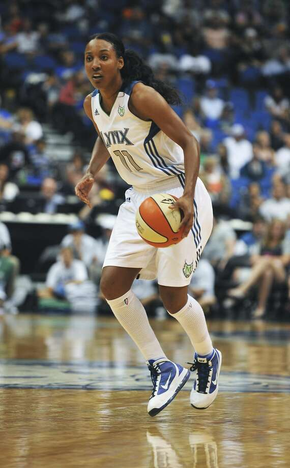 Candice Wiggins, who retired in March after eight years in the WNBA in March, says players were encouraged to look and act like the men in the NBA. Photo: Tom Olmscheid, AP