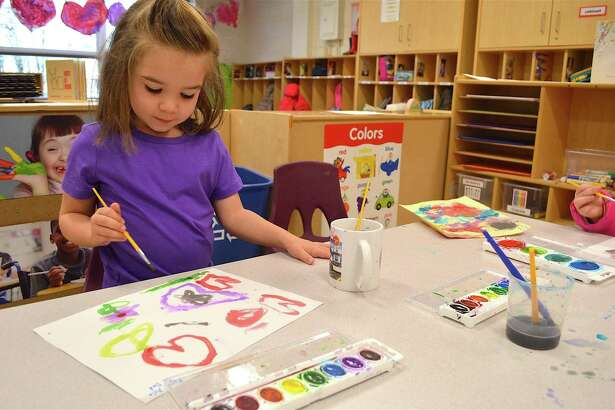 Ayla Martocci, 4, of Westport, paints a picture for her father at the Earthplace Vacation Drop-Off Program, Monday, Feb. 20, 2017, in Westport, Conn.