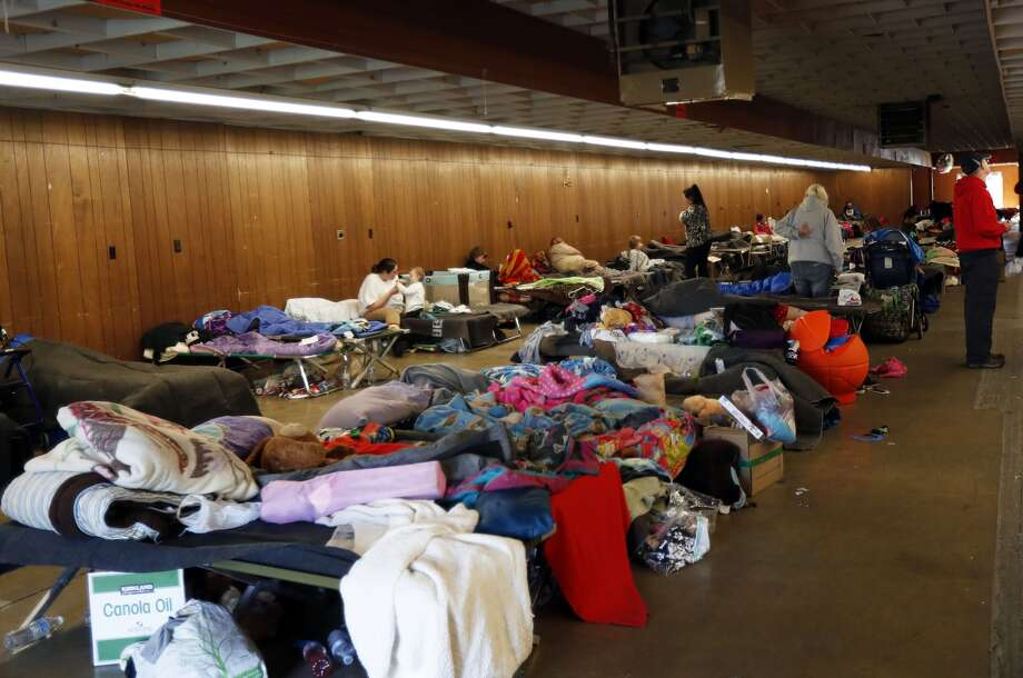 Evacuees from the Oroville Dam area are seen at a temporary shelter in the Silver Dollar Fairgrounds in Chico, California on February 14, 2017. A sheriff lifted a mandatory evacuation order in northern California, which had impacted nearly 200,000 people in an area under threat of catastrophic failure at the tallest dam in the United States. / AFP / MONICA DAVEY