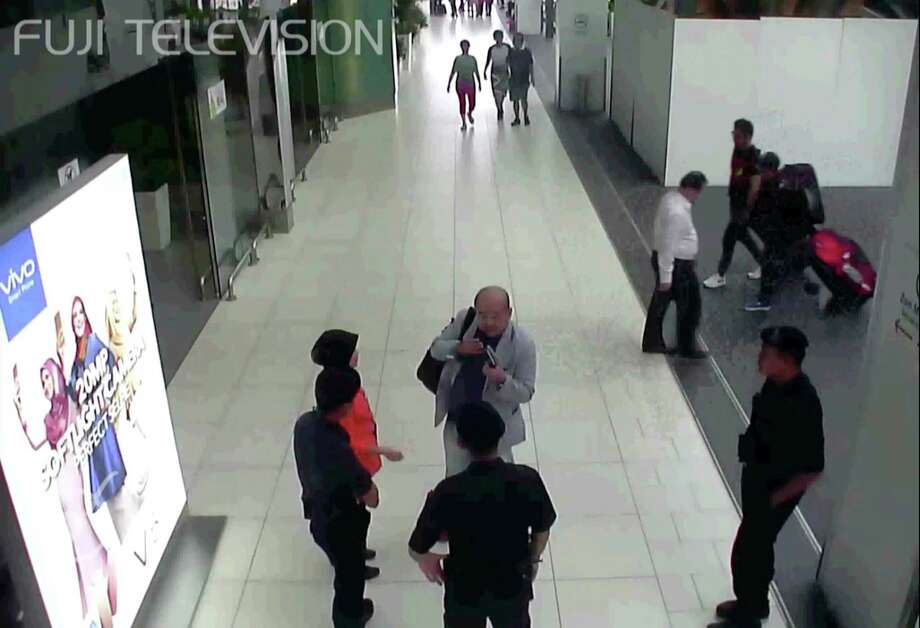 Kim Jong Nam, at center with arm bag, talks to airport security and officials after he was attacked at Kuala Lumpur International Airport, Malaysia. Kim, the estranged half brother of North Korean ruler Kim Jong Un, died last week after apparently being poisoned. Photo: TEL / Fuji Television