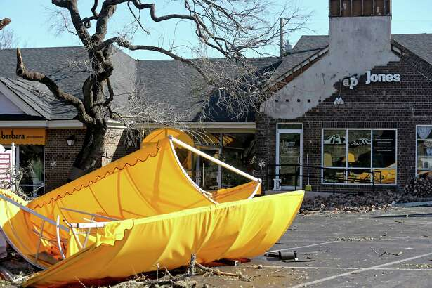 A view of damage at the Carousel Court after tornadoes moved through the area late Sunday night.