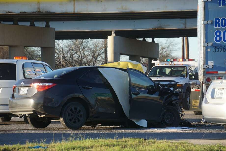 A driver of a dark-colored sedan was killed in a collision with an 18-wheeler on Loop 410 Monday, Feb. 20, 2017. Photo: Jacob Beltran