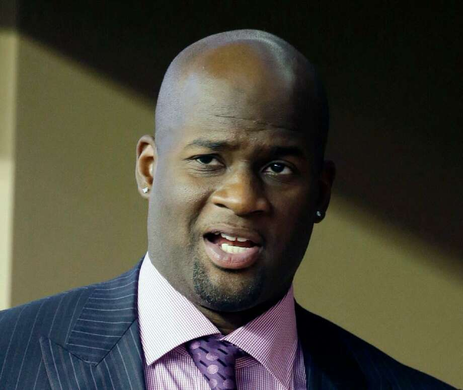 "In this Sept. 13, 2014, file photo, Vince Young is shown in a suite during a college football game in Arlington, Texas. Vince Young still isn't quite ready to call it a career. The two-time Pro Bowl quarterback has hired agent Leigh Steinberg, who welcomed his new client on Twitter on Wednesday, Feb. 15, 2017, and said Young ""has dream of playing more football, being role model."" Photo: Tony Gutierrez /AP Photo /"