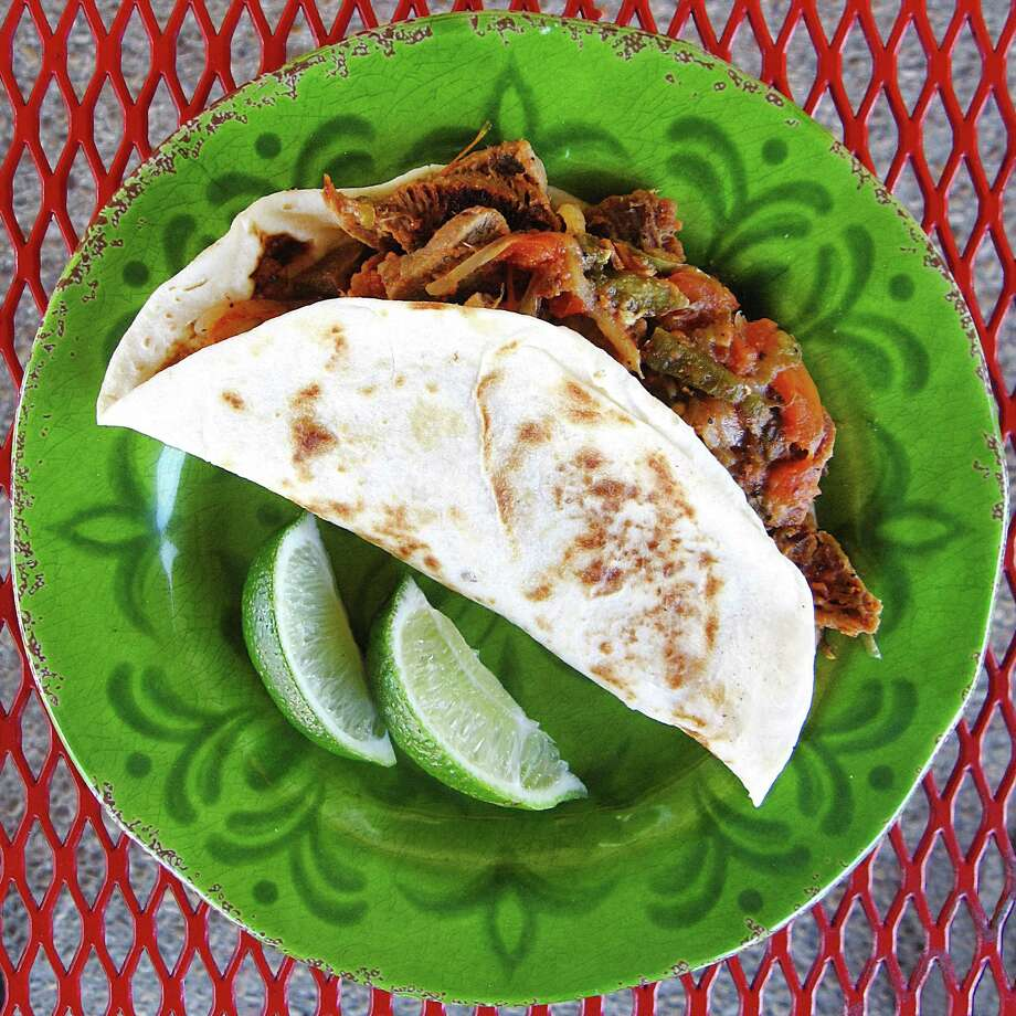 Lengua ranchera taco on a handmade flour tortilla from Mi Guadalajara. Photo: Mike Sutter /San Antonio Express-News