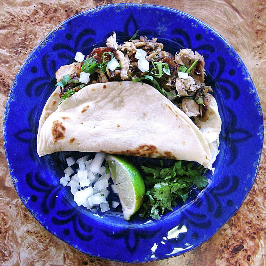 Pierna de puerco (pork leg) taco on a handmade flour tortilla from El Gallito de Jalisco on Wurzbach Road. Photo: Mike Sutter /San Antonio Express-News
