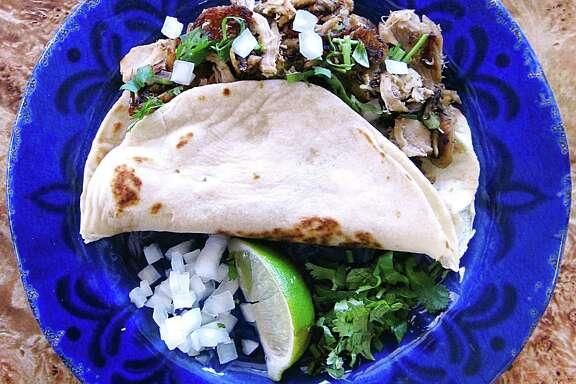 Pierna de puerco (pork leg) taco on a handmade flour tortilla from El Gallito de Jalisco on Wurzbach Road.