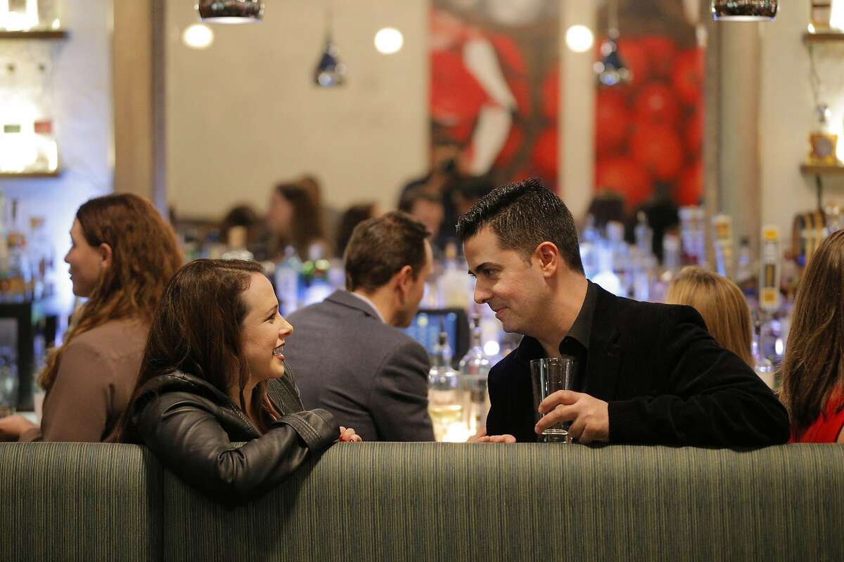 Jenn Collens, left, and Joe DeRose, right, chat during a Three Day Rule matchmaking event at LV Mar Restaurant in Redwood City, Calif., on Wednesday, February 8, 2017. The matchmaking service Three Day Rule launched a chapter in Silicon Valley, hoping to help techies too busy to find love make the right match.