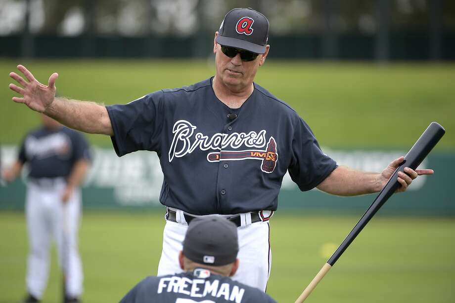 FILE - In this Feb. 18, 2017, file photo, Atlanta Braves manager Brian Snitker talks with infielder Freddie Freeman during the first full-squad spring training workout in Lake Buena Vista, Fla. With his career in baseball approaching four decades long, he figured there wasn't much chance of actually getting the call to the big leagues. But here he is _ finally, at the age of 61 _ getting ready for his first full season as manager of the Atlanta Braves. (AP Photo/Phelan M. Ebenhack, File) Photo: Phelan M. Ebenhack, Associated Press