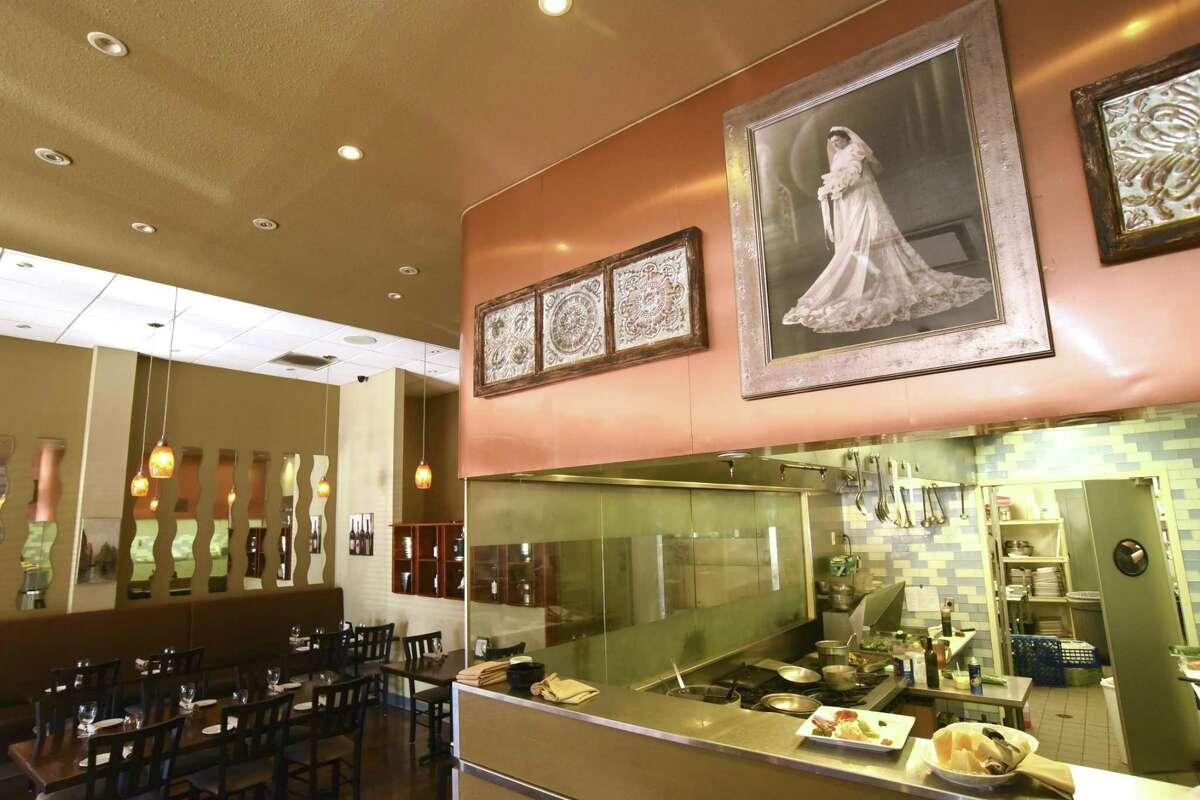 A portrait of Julia Paparella, grandmother of Chef Andrew Paparella Jr., has a prominent place at Rossini Italian Bistro.