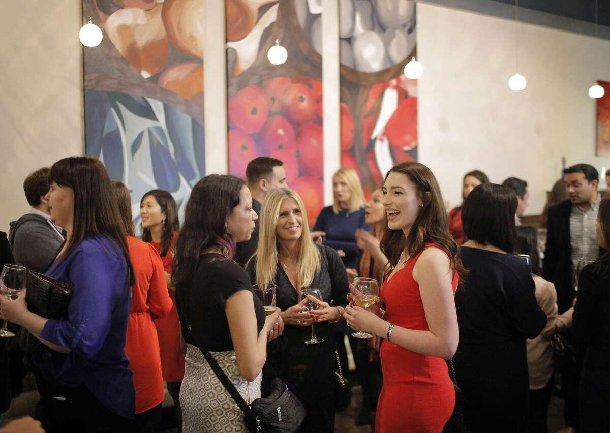 Guests and matchmakers chat during a Three Day Rule matchmaking event at LV Mar Restaurant in Redwood City, Calif., on Wednesday, February 8, 2017. The matchmaking service Three Day Rule launched a chapter in Silicon Valley, hoping to help techies too busy to find love make the right match.