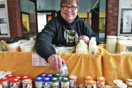 Marge Randles at their Argyle Cheese booth at the Troy Winter Farmers Market Saturday Feb. 18, 2017 in Troy, NY.  (John Carl D'Annibale / Times Union)