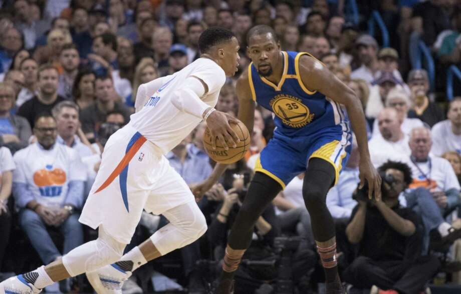 OKLAHOMA CITY, OK - FEBRUARY 11:  Russell Westbrook #0 of the Oklahoma City Thunder drives around Kevin Durant #35 of the Golden State Warriors during the second half of a NBA game at the Chesapeake Energy Arena on February 11, 2017 in Oklahoma City, Oklahoma.   NOTE TO USER: User expressly acknowledges and agrees that, by downloading and or using this photograph, User is consenting to the terms and conditions of the Getty Images License Agreement. (Photo by J Pat Carter/Getty Images) ORG XMIT: 662355697 Photo: J Pat Carter / 2017 Getty Images