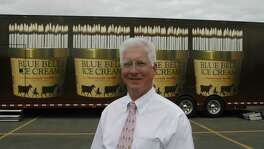 "12/28/06--Paul Kruse is CEO and President of Blue Bell Creameries. Behind him is the 18 wheel trailer truck that will tour next year as part of the 100th anniversary of Blue Bell.  Blue Bell Ice Cream will celebrate its 100th anniversary next year. Included in the celebration will be a ""Days in the Country"" sculpture garden at the Washington County Fairgrounds, a ""Name That Flavor"" contest, an anniversary book about the history of Blue Bell, and an anniversary cookbook.  There will also be an 18 wheel truck with Blue Bell exhibits that will tour 66 cities in the Blue Bell market area, Starting with Phoenix and Tucson, AZ.  Photo by Steve Campbell, Chronicle Staff"