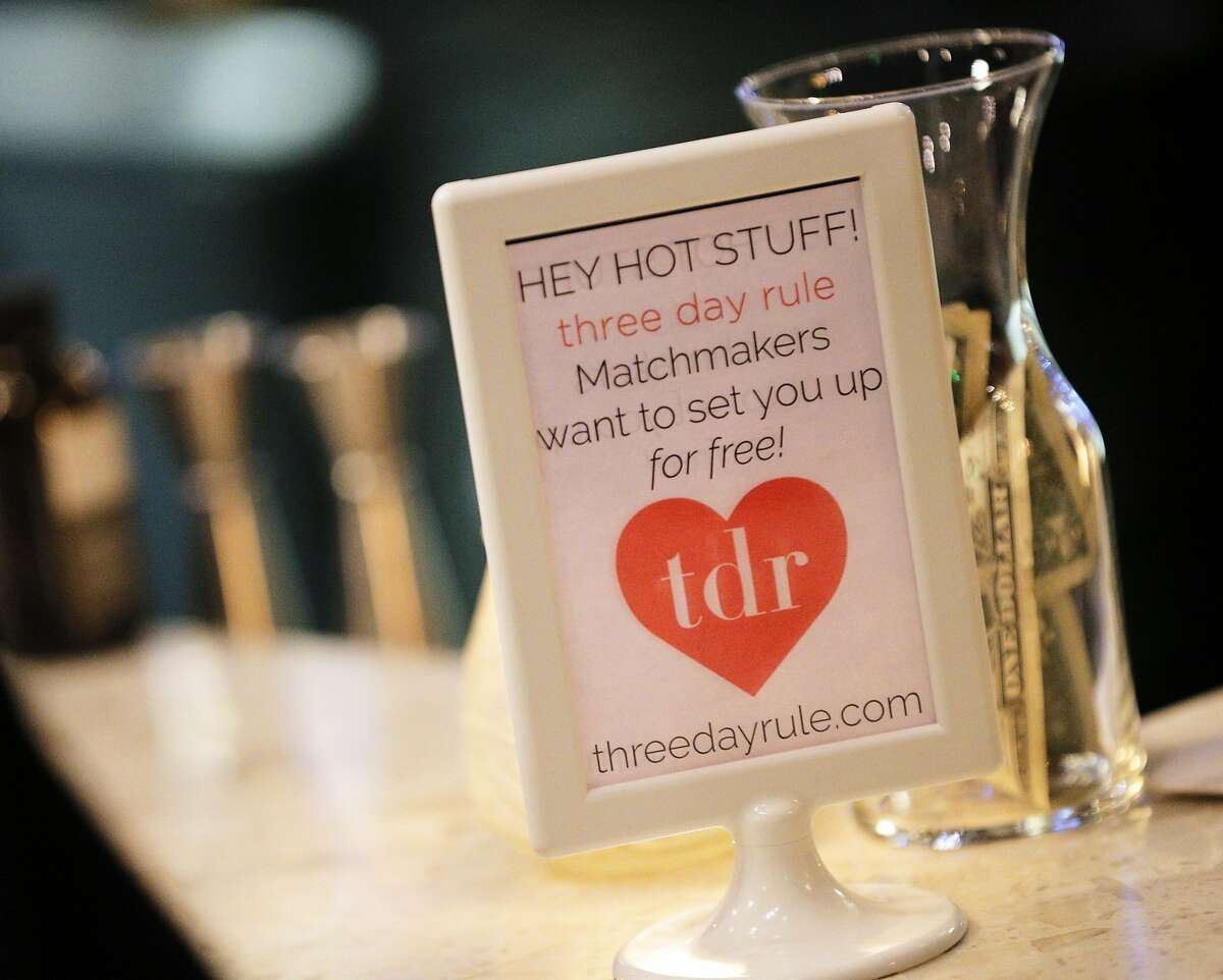 Some event signage on the bar during a Three Day Rule matchmaking event at LV Mar Restaurant in Redwood City, Calif., on Wednesday, February 8, 2017. The matchmaking service Three Day Rule launched a chapter in Silicon Valley, hoping to help techies too busy to find love make the right match.