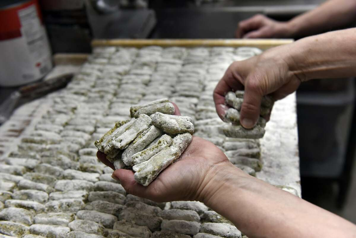 Joanne Cittoni Gonzalez grabs a handful of fresh made Malfatti to throw into a pot of boiling water, in the kitchen at Clemente's Authentic Italian Takeout in Napa, CA, on Monday February 20, 2017.