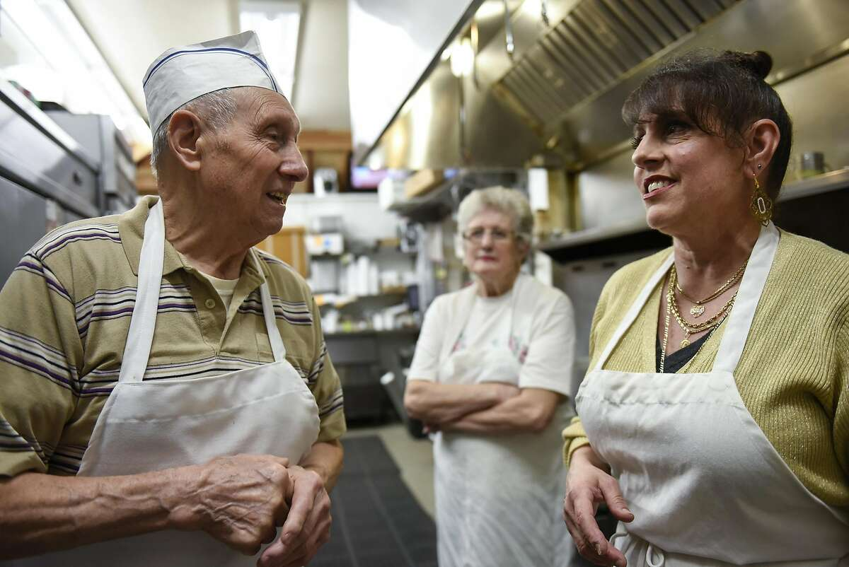Clement Cittoni, his wife Mary Cittoni, and their daughter Joanne Cittoni Gonzalez talk about the history of the Malfatti and their business in the kitchen at Clemente's Authentic Italian Takeout in Napa, CA, on Monday February 20, 2017.